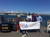 Conor Cummins rides TT course with Manx MSA Trust auction winners