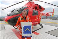 London Air Ambulance Medical Director presented with Freemasonry stamp and £1500 donation