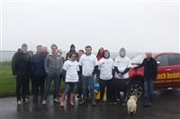 Grant Thornton staff endure a downpour to clean the Beach