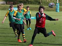 Old Mutual International helps promote rugby in schools with Kids First scheme