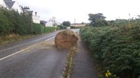 Tractor sheds hay bale in Ramsey