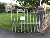 Church gates damaged after crash