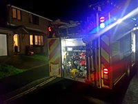 Candle sparks house fire in Douglas