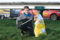 Nine year old sets litter picking example